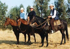 Tom, Ray Hunt and Bill Dorrance on horseback